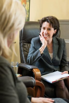 Psychologist with a female client.